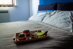Messy bedroom and breakfast kitchen ware Stock Images