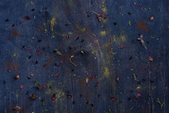 Messy blue wooden texture background copy space. Berries, nuts, spises leftovers. Royalty Free Stock Photography