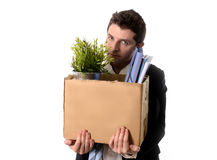 Messy Business Man with cardboard box Fired from Job Royalty Free Stock Photos