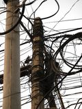 MESSY CABLE ELECTRICITY POST Stock Photos