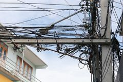 Messy cable electricity post. Stock Photo