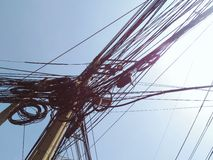 Messy cable wire on electric pole against blue sky. Messy cable wire on electric pole against clear blue sky Stock Photography
