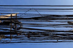 Messy cables attached to electrics pole. Messy cables attached to electrics pole Including electrics, phone and others communication cables, Bangkok, Thailand stock images