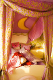 Messy children's room. Messy child room or bedroom with unmade bed, pink canopy and pillows Royalty Free Stock Photos