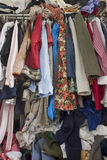 Messy closet overfilled with clothes Royalty Free Stock Photo