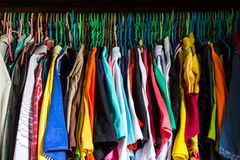 Messy closet overfilled with colorful woman clothes on hangers Royalty Free Stock Photography