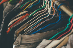 Messy clothes. In closet hanging on rack Royalty Free Stock Images