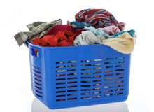 Messy clothes in laundry container Royalty Free Stock Photos
