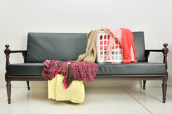 Messy clothes scattered in the basket on a sofa Stock Photography