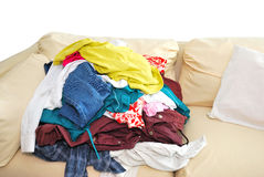 Messy clothes on sofa Stock Images