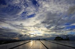 Messy Cloud over Solar PV Rooftop System. During the sunset stock photography