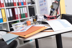 Messy and cluttered desk stock images