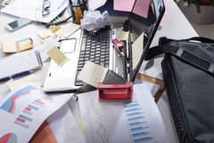 Messy and cluttered desk royalty free stock photography