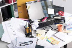 Messy and cluttered desk. Messy and cluttered office desk royalty free stock image