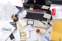 Messy and cluttered desk stock image