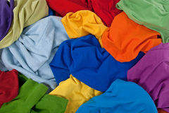 Messy colorful clothes background Stock Photos