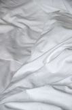 Messy and creased white fabric of bedsheet Royalty Free Stock Photography