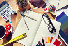 Messy Designer's Table with a lot of Tools Stock Images
