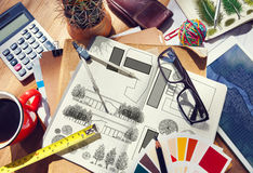 Messy Designer's Table with Project Plan and Tools Royalty Free Stock Photo