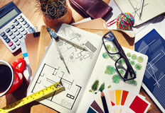 Messy Designer's Table with Sketch and Tools Royalty Free Stock Photo