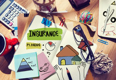 Messy Desk with Insurance Related Notes Stock Images