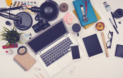 Messy desk responsive hero header. Top view of messy desk with smartphone, computer, tablet and other office items. Hero header of mockup Stock Photos