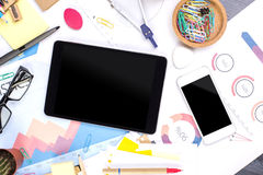 Messy desk with technology Royalty Free Stock Photography