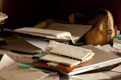 Messy Disorganized Desk. A messy desk representing our over-booked, hassled lives. Suggests a person with too much to do and not enough time Royalty Free Stock Images