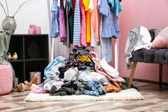 Messy dressing room interior. With clothes rack royalty free stock images