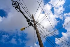 Messy electric aerial wires and pole Mexico Royalty Free Stock Photos