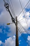 Messy electric aerial wires and pole Mexico Royalty Free Stock Image