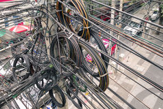 Messy electrical cables in Bangkok city - Optical fiber technology Stock Photo