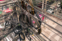 Messy electrical cables in Bangkok city Stock Images