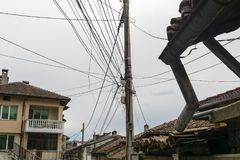 Messy electrical cables and wires on electric pole. In Veliko tarnovo, Bulgaria Stock Image