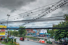 Messy electrical and optic fiber cables in thailand Stock Photography