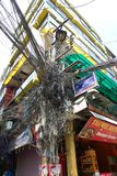 Messy electrical wiring over a post, Kathmandu, Nepal stock image