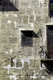 Messy facade of an old building. Detailed view of the facade of an old building, with cables and plumbings, portrait cut Royalty Free Stock Photo