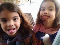 Messy face. Two cuties have chocolate ob face Stock Photography
