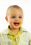 Messy faced baby after eating Stock Image