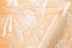 Messy floured wooden surface/ background and rolling pin. Messy floured wooden surface/ background and rolling pin Stock Photo