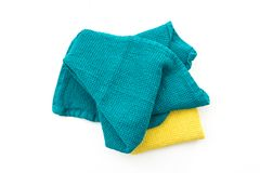 Messy and folded colorful kitchen towels, on white. Background Stock Images