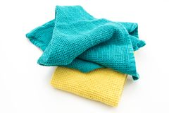 Messy and folded colorful kitchen towels, on white. Background Stock Image