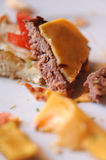 Messy food leftovers. Burger leftover on the plate after party Royalty Free Stock Photography