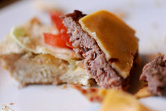 Messy food leftovers. Burger leftovers after party Stock Photography