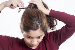 Messy Frizzy Hair. Young lady fixing a messy frizzy hair royalty free stock photo