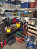 Messy Garage Storage. Cluttered corner of a busy residential garage Royalty Free Stock Image