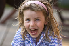 Messy Girl Laughing Royalty Free Stock Image