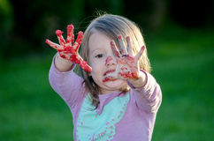 Messy girl with red frosting Royalty Free Stock Images