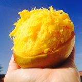 Messy hair mango. A bright contrast of stock image