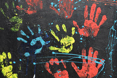Messy handprints dripping paint Stock Photo